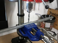Drill press is so darn handy! Im using my new drill press to make the holes in the brackets which screw in to the wood