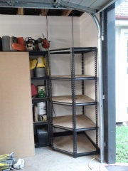 The empty corner shelf was removed to make room for us to work