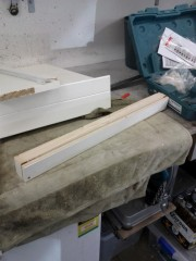 Make a fascia/spacer to sit between the dryer and the shelf
