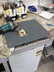 Preparing to cut a hole in the blue board for the vent
