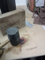 Flattening copper with rubber mallet