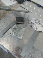Cleaning the plate with sandpaper