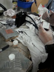 Adding heat transfer paste. Be sure to wear gloves when doing this. Not so good if the paste gets on your skin.