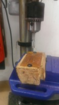 Clamped down in a vice while I use the drill press to drill the holes in the PCB