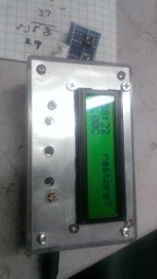 Drill holes and mount the button PCB to the enclosure