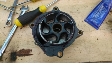 Push the new impeller in place while rotating it anti-clockwise.