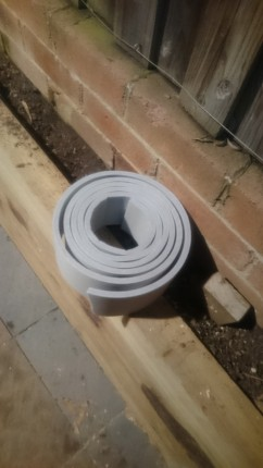 Foam roll used between lapped fence and roof structure of shed.
